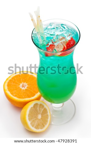 Tropical Alcoholic Drink Made of Rum, Pineapple Juice, Blue Curacao, Sweet and Sour Mix. Slice of Apple and Strawberry as a Garnish. - stock photo