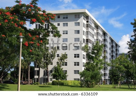 Tropical apartment building over looking a golf course - stock photo