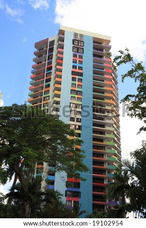 Tropical apartment building over looking the bay - stock photo