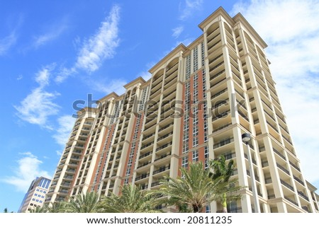 Tropical apartment building over looking the ocean - stock photo