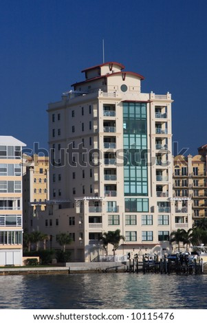Tropical apartment buildings over looking the bay - stock photo