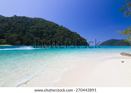 Tropical beach against blue sky at Koh Mai ngam in Surin Islands national park in Phang Nga, Thailand