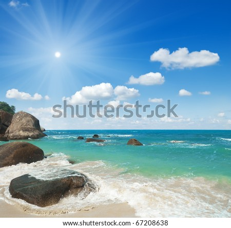 Tropical beach and blue sky. - stock photo
