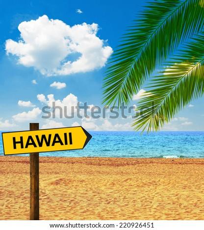 Tropical beach and direction board saying HAWAII - stock photo