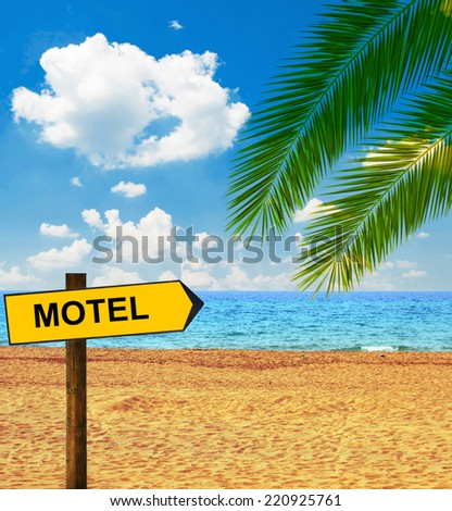 Tropical beach and direction board saying MOTEL - stock photo