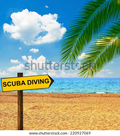 Tropical beach and direction board saying SCUBA DIVING - stock photo