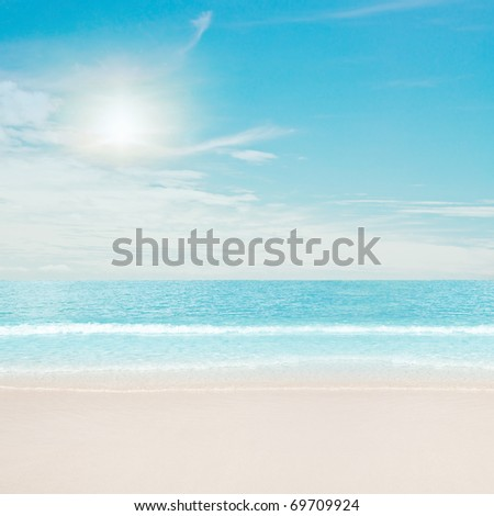 Tropical beach and ocean. Sun and clouds - stock photo