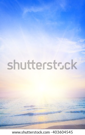 Tropical beach and sea at sunrise, beautiful colorful holiday background - stock photo