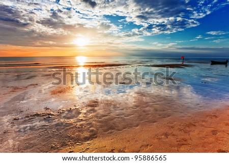 Tropical beach at beautiful sunset. Nature background - stock photo
