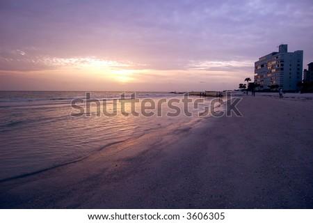 Tropical beach at dusk - stock photo