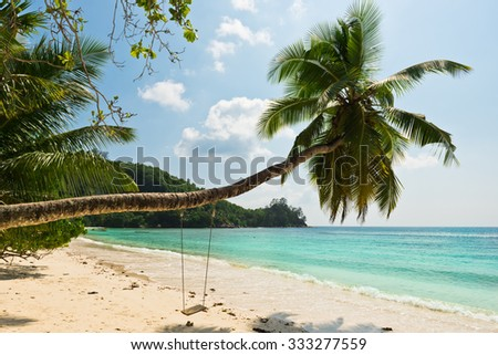 Tropical beach at Mahe island Seychelles. Horizontal shot with a selective focus
