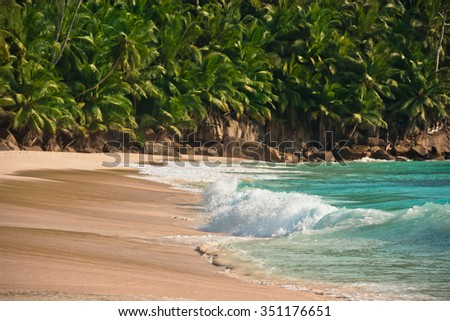 Tropical beach at Mahe island Seychelles in sunny day - stock photo