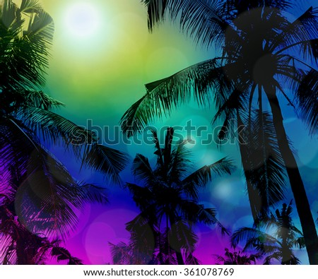 Tropical beach at night with a full moon reflecting   and a coconut palms on the foreground    Effect bokeh. Bali - stock photo