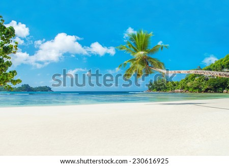 Tropical beach Baie Lazare with boat, Mahe island, Seychelles - vacation background - stock photo