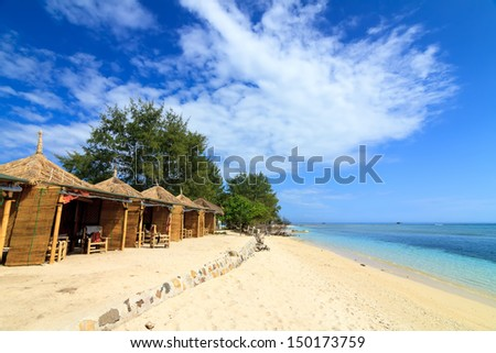 Tropical beach bungalow on ocean shore, Gili Meno, Lombok, Indonesia - stock photo