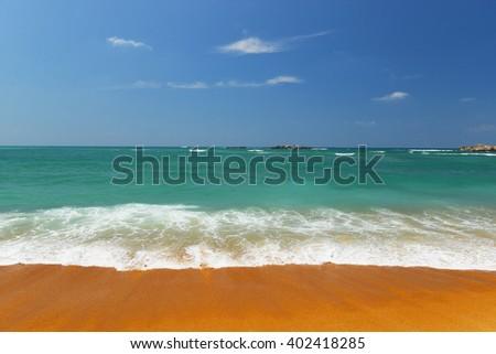 Tropical beach in Indian Ocean, Srilanka - stock photo