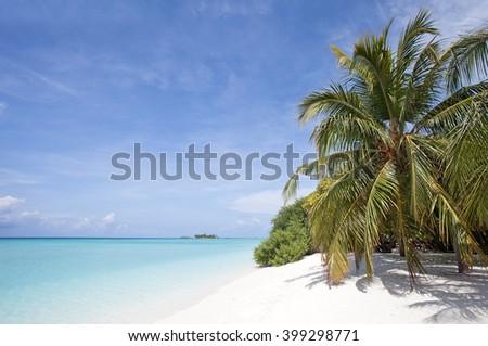 Tropical beach in Nalaguraidhoo Island in Maldive Islands,Indian Ocean - stock photo