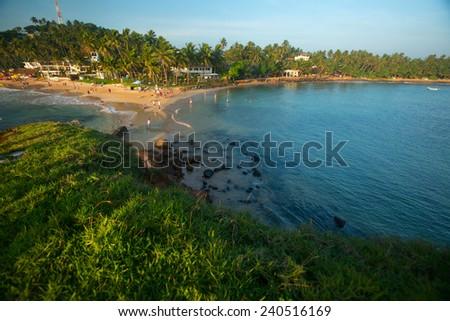 Tropical beach in the town of Mirissa, Sri Lanka - stock photo
