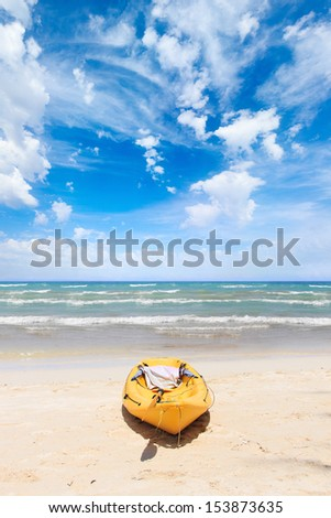 Tropical beach landscape with canoe boat at ocean gulf under blue sky. Ko Phi Phi Don, Thailand - stock photo