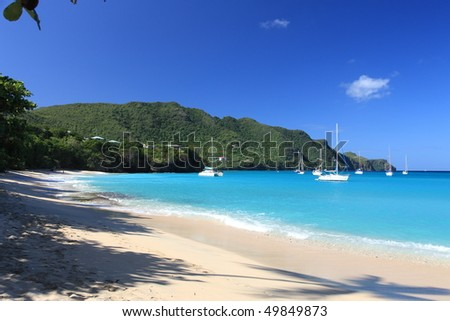 Tropical beach on Bequia Island, St. Vincent in the Caribbean - stock photo