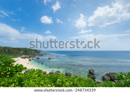 Tropical beach paradise full of clear turquoise water and healthy coral reef by perfect white sand beach in Miyako-jima, Okinawa, Japan - stock photo