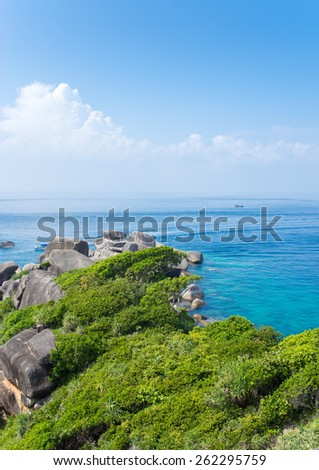 Tropical beach paradise seascape of Ko Similan National Marine park in Phang Nga province of Southern Thailand boasting lush green vegetation and clear turquoise water - stock photo