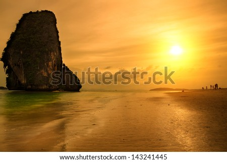 Tropical beach railay beach in krabi thailand at sunset - stock photo