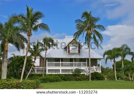 Tropical beach setting with a beautiful Florida style home - stock photo
