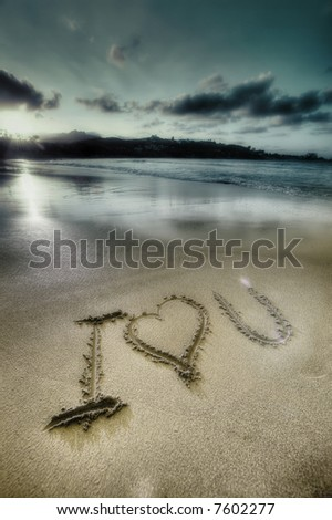 Tropical beach - sunset - i love you ,sign on the sand - stock photo