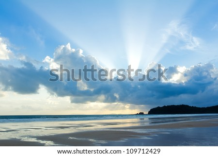 Tropical beach Sunset Sky With Lighted Clouds - stock photo