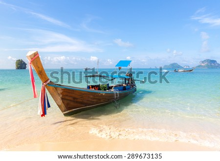 Tropical beach, traditional long tail boats, Andaman Sea, Thailand - stock photo