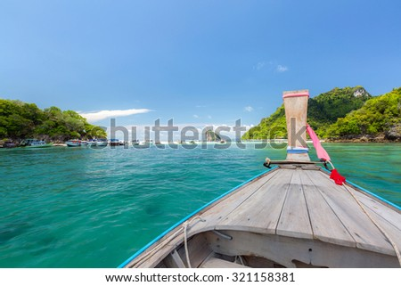 Tropical beach, traditional long tail boats, Andaman Sea, Thailand - stock photo