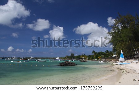 Tropical beach with boats, Mauritius - stock photo