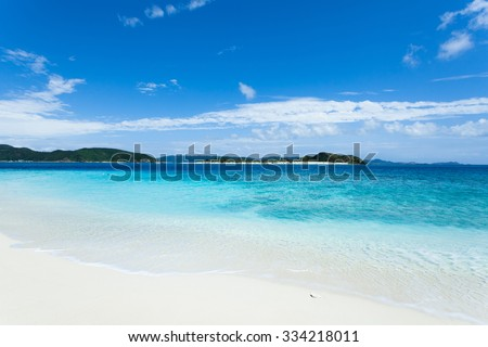 Tropical beach with clear blue water and white sand on a deserted coral island, Kerama Islands National Park, Okinawa, Japan - stock photo