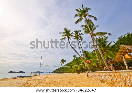 Tropical Beach With Volleyball net - stock photo
