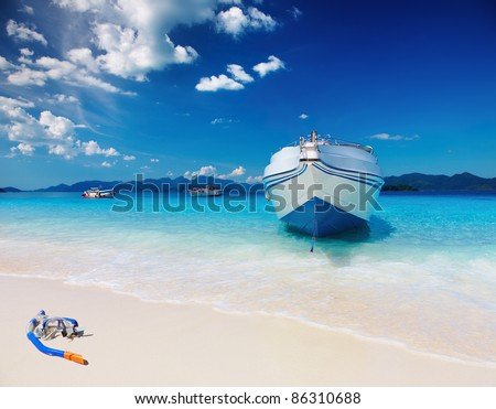 Tropical beach with white sand and azure sea - stock photo