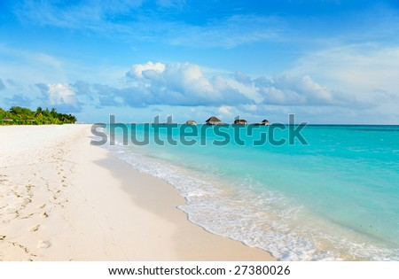tropical beach with wide sand strip - stock photo