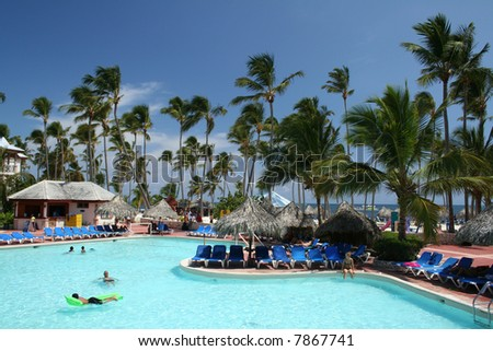 Tropical beachfront all-inclusive resort - stock photo
