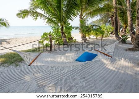 Tropical beautiful beach and hammock on the island Koh Kood, Thailand - stock photo