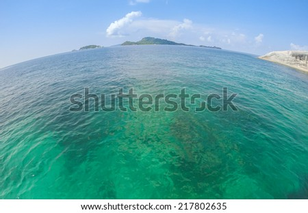Tropical beautiful Sea with small island (fish-eye lens) - stock photo