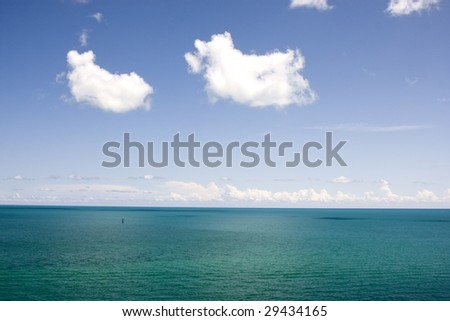 Tropical Blue Water with Clouds off of Key West - stock photo