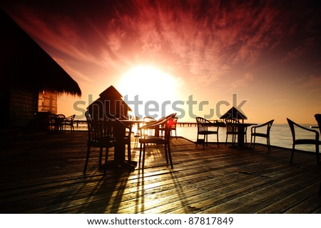 tropical cafe on the sunset - stock photo