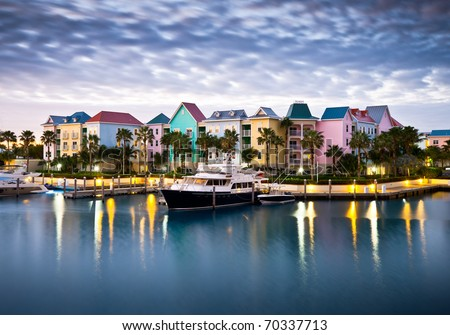 Tropical Caribbean Harbor Marina in Morning Light w/ Boats and Pastel Houses - stock photo