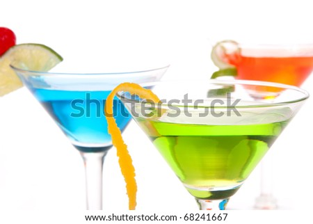 Tropical citrus martini Cocktails with vodka, light rum, gin, tequila, blue curacao, lime juice, lemonade, lemon slice, maraschino cherry isolated on a white background - stock photo