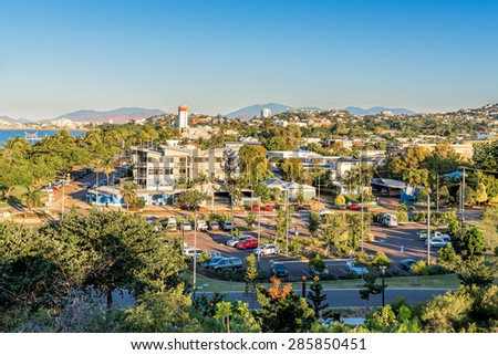 Tropical city at sunset from aerial view - stock photo