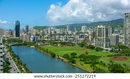 Tropical city honolulu, Hawaii island of Oahu, the view from Waikiki over above the ala wai canal  - stock photo