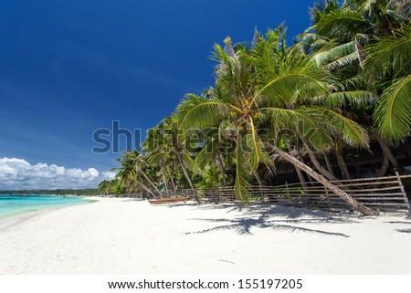 Tropical coastline with beautiful palm and white sand, Philippines, Boracay Island - stock photo