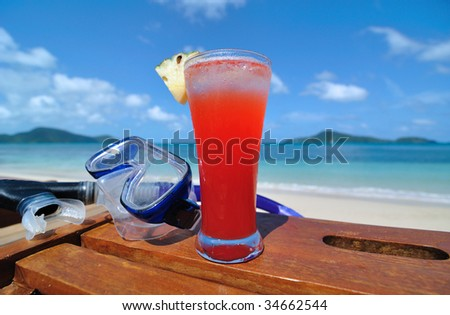 Tropical Cocktail at the Beach - stock photo