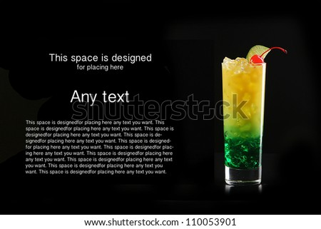 Tropical cocktail isolated on black background with cocktail cherry - stock photo