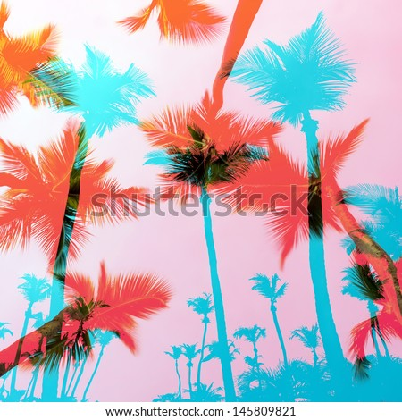 Tropical coconut palm tree silhouettes montage over a tropical sky. - stock photo
